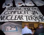 """Body bag"" die-in, radiation kills, submissions to the committee"