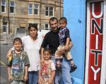 Temal family safely back in Glasgow outside the Unity Centre