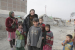 Maya Evans with children in a refugee camp
