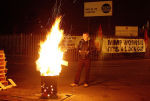 A picketer keeps the fire burning through the night in Bootle this week