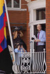 Julian Assange appears on the balcony of the Ecuadorian Embassy