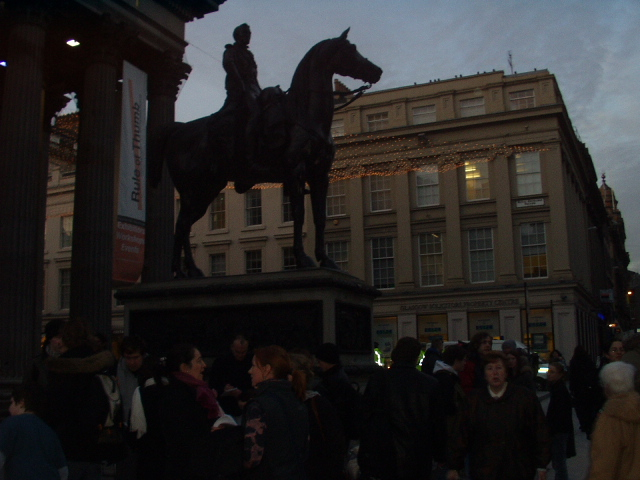 Crowd gathering by Wellington statue. Note absence of usual traffic cones.