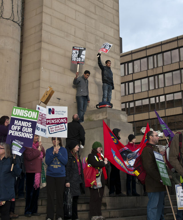 Cameron out!...Students climb city hall to make their point.
